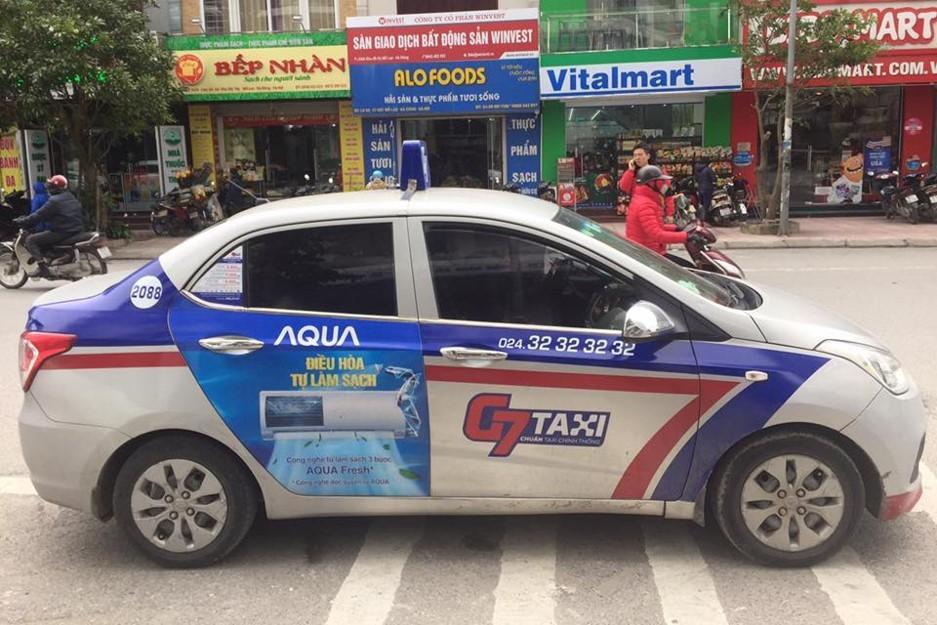 quang-cao-tren-xe-taxi-g7-3